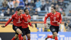 Al Ahly's Ahmed El Sayed, Shady Mohamed and Mohamed Aboutrika celebrate a goal against Pachuca