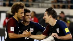 JACKSONVILLE, FL - SEPTEMBER 06:  Sacha Kljestan #16 of the United States (R) is congratulated by Christian Pulisic #10 and Fabian Johnson #23 following a goal during the FIFA 2018 World Cup Qualifier against Trinidad &Tobago at EverBank Field on September 6, 2016 in Jacksonville, Florida.  (Photo by Sam Greenwood/Getty Images)