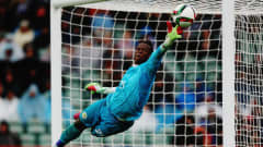 AUCKLAND, NEW ZEALAND - JUNE 20: Ibrahima Sy of Senegal dives to save a goal during the FIFA U-20 World Cup Third Place Play-off match between Senegal and Mali at North Harbour Stadium on June 20, 2015 in Auckland, New Zealand.  (Photo by Hannah Peters/Getty Images)