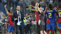 Barcelona´s coach Josep Guardiola (L) celebrates with players after the trophy ceremony of the final of the UEFA football Champions League
