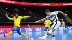 KAUNAS, LITHUANIA - SEPTEMBER 16: Bruno Coelho of Portugal shoots as Samuel Osifelo of Solomon Islands attempts to block during the FIFA Futsal World Cup 2021 group C match between Solomon Islands and Portugal at Kaunas Arena on September 16, 2021 in Kaunas, Lithuania. (Photo by Angel Martinez - FIFA/FIFA via Getty Images)