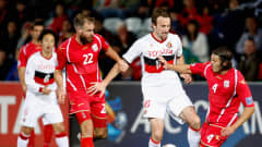 Josh Kennedy of Nagoya is challenged by Jonathan Mckain and Iain Fyfe of Adelaide United during the AFC Asian Champions League match between Adelaide United and Nagoya Grampus at Hindmarsh Stadium on May 29, 2012 in Adelaide, Australia.