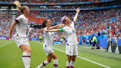 LYON, FRANCE - JULY 07:  Megan Rapinoe of the USA celebrates with teammates Alex Morgan and Samantha Mewis after scoring her team's first goal during the 2019 FIFA Women's World Cup France Final match between The United States of America and The Netherlands at Stade de Lyon on July 07, 2019 in Lyon, France. (Photo by Richard Heathcote/Getty Images)
