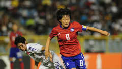 PORT OF SPAIN, TRINIDAD AND TOBAGO - SEPTEMBER 25: Kim Areum of South Korea is challenged by Yoko Tanaka of Japan during the FIFA U17 Women's World Cup Final match between South Korea and Japan at the Hasely Crawford Stadium on September 25, 2010 in Port of Spain, Trinidad And Tobago. (Photo by Shaun Botterill - FIFA/FIFA via Getty Images)