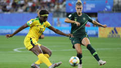 GRENOBLE, FRANCE - JUNE 18: Khadija Shaw of Jamaica is closed down by Steph Catley of Australia during the 2019 FIFA Women's World Cup France group C match between Jamaica and Australia at Stade des Alpes on June 18, 2019 in Grenoble, France. (Photo by Elsa/Getty Images)