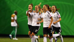 MONTREAL, QC - AUGUST 24: Lena Petermann #18 of Germany celebrates her team's first goal with team mates during the FIFA U-20 Women's World Cup Canada 2014 final match between Nigeria and Germany at Olympic Stadium on August 24, 2014 in Montreal, Canada.  (Photo by Alex Grimm - FIFA/FIFA via Getty Images)
