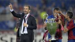 Barcelona´s coach Josep Guardiola (L) celebrates with players after the trophy ceremony of the final of the UEFA football Champions League 0001-01-01 00:00:00