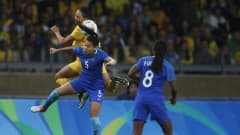 BELO HORIZONTE, BRAZIL - AUGUST 12: Thaisa of Brazil and Kyah Simon (L) of Australia compete for the ball during the Women's Quarter Final match between Brasil and Australia on Day 7 of the Rio2016 Olympic Games at Mineirao Stadium on August 12, 2016 in Belo Horizonte, Brazil.  (Photo by Joern Pollex - FIFA/FIFA via Getty Images)