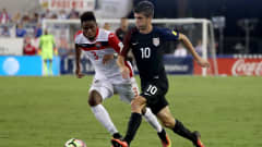 JACKSONVILLE, FL - SEPTEMBER 06:  Christian Pulisic #10 of the United States drives past Joevin Jones #3 of Trinidad & Tobago during the FIFA 2018 World Cup Qualifier at EverBank Field on September 6, 2016 in Jacksonville, Florida.  (Photo by Sam Greenwood/Getty Images)