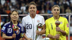 Homare Sawa of Japan, Abby Wambach and Hope Solo of USA pose for a photo after the FIFA Women's World Cup Final match between Japan and USA at the FIFA World Cup stadium Frankfurt on July 17, 2011 in Frankfurt am Main, Germany. (Photo by Martin Rose/Getty Images)