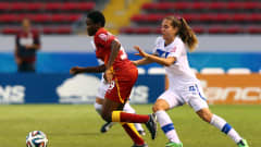 SAN JOSE, COSTA RICA - MARCH 27: Sandra Owusu Ansah (L) of Ghana and Federica Cavicchia (R) of Italy battle for the ball during the FIFA U-17 Women's World Cup 2014 quarter final match between Ghana and Italy at Estadio Nacional on March 27, 2014 in San Jose, Costa Rica.  (Photo by Martin Rose - FIFA/FIFA via Getty Images)