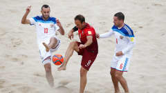 ESPINHO, PORTUGAL - JULY 18:  Ze Maria of Portugal battles for the ball with Artur Paporotnyi (L) and Dmitrii Shishin of Russia during the FIFA Beach Soccer World Cup semi final match between Portugal and Russia held at Espinho Stadium on July 18, 2015 in Espinho, Portugal.  (Photo by Dean Mouhtaropoulos - FIFA/FIFA via Getty Images)