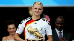 BIELEFELD, GERMANY - AUGUST 01: Alexandra Popp of Germany celebrates receiving the trophy as the best goal scorer during the FIFA U20 Women's World Cup Final match between Germany and Nigeria at the FIFA U-20 Women's World Cup stadium on August 1, 2010 in Bielefeld, Germany. (Photo by Friedemann Vogel - FIFA/FIFA via Getty Images)