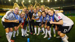 MONTREAL, QC - AUGUST 24:  Players of Germany celebrate after winning the FIFA U-20 Women's World Cup Canada 2014 final match between Nigeria and Germany at Olympic Stadium on August 24, 2014 in Montreal, Canada.  (Photo by Alex Grimm - FIFA/FIFA via Getty Images)