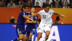 FRANKFURT AM MAIN, GERMANY - JULY 17:  Abby Wambach of USA holds off a challenge from Saki Kumagai of Japan during the FIFA Women's World Cup Final match between Japan and USA at the FIFA Women's World Cup Stadium on July 17, 2011 in Frankfurt am Main, Germany.  (Photo by Alex Livesey - FIFA/FIFA via Getty Images)