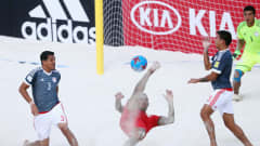 NASSAU, BAHAMAS - MAY 04: Heimanu Taiarui of Tahiti attempts a bicycle kick between Gustavo Benitez (L) and Jesus Rolon of Paraguay during the FIFA Beach Soccer World Cup Bahamas 2017 quarter final match between Paraguay and Tahiti at National Beach Soccer Arena at Malcolm Park on May 4, 2017 in Nassau, Bahamas.  (Photo by Alex Grimm - FIFA/FIFA via Getty Images)