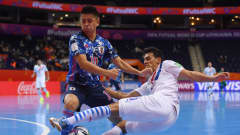 VILNIUS, LITHUANIA - SEPTEMBER 20: Richard Rejala of Paraguay is challenged by Katsutoshi Henmi of Japan during the FIFA Futsal World Cup 2021 group E match between Japan and Paraguay at Vilnius Arena on September 20, 2021 in Vilnius, Lithuania. (Photo by Alex Caparros - FIFA/FIFA via Getty Images)