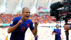 PORTO ALEGRE, BRAZIL - JUNE 18:  Arjen Robben of the Netherlands celebrates after scoring the team's first goal during the 2014 FIFA World Cup Brazil Group B match between Australia and Netherlands at Estadio Beira-Rio on June 18, 2014 in Porto Alegre, Brazil.  (Photo by Ryan Pierse - FIFA/FIFA via Getty Images)