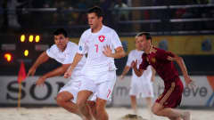 DUBAI, UNITED ARAB EMIRATES - NOVEMBER 20: Sandro Spaccarotella of Switzerland breaks away with Dejan Stankovic in support during the FIFA Beach Soccer World Cup Quarter Final match between Russia and Switzerland at Umm Sequim beach on November 20, 2009 in Dubai, United Arab Emirates. (Photo by Mike Hewitt - FIFA/FIFA via Getty Images)