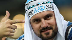 A fan of Gremio vibrates before the first leg match between Gremio and Lanus