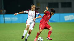 NANJING, CHINA - AUGUST 26:  Deyna Castellanos of Venezuela battles with Zhang Jiayun of China during the 2014 FIFA Girls Summer Youth Olympic Football Tournament Gold/Silver Medal match between Venezuela and China at Wutaishan Stadium at Wutaishan Stadium on August 26, 2014 in Nanjing, China.  (Photo by Stanley Chou - FIFA/FIFA via Getty Images)