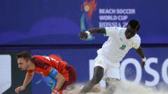 MOSCOW, RUSSIA - AUGUST 29: Mamour Diagne of Senegal is challenged by Noel Ott of Switzerland during the FIFA Beach Soccer World Cup 2021 3rd Place match between Switzerland and Senegal at Luzhniki Beach Soccer Stadium on August 29, 2021 in Moscow, Russia. (Photo by Octavio Passos - FIFA/FIFA via Getty Images)