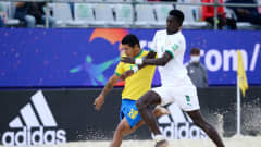 MOSCOW, RUSSIA - AUGUST 26: Datinha of Brazil battles for possession with Mandione Diagne of Senegal during the FIFA Beach Soccer World Cup 2021 Quarter-final match between Senegal and Brazil at Luzhniki Beach Soccer Stadium on August 26, 2021 in Moscow, Russia. (Photo by Octavio Passos - FIFA/FIFA via Getty Images)