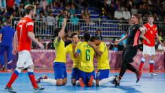 BUENOS AIRES, ARGENTINA - OCTOBER 18:  Brazil celebrates their first goal against Russia scored as an own goal by Danil Karpiuk #4 in the Men's Futsal Final match between Brazil and Russia during the Buenos Aires Youth Olympics 2018 at Tecn—polis on October 18, 2018 in Buenos Aires, Argentina.  (Photo by Kevin C. Cox - FIFA/FIFA via Getty Images)
