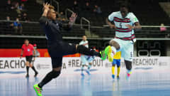 KAUNAS, LITHUANIA - SEPTEMBER 16: Zicky of Portugal is challenged by Anthony Talo of Solomon Islands during the FIFA Futsal World Cup 2021 group C match between Solomon Islands and Portugal at Kaunas Arena on September 16, 2021 in Kaunas, Lithuania. (Photo by Angel Martinez - FIFA/FIFA via Getty Images)