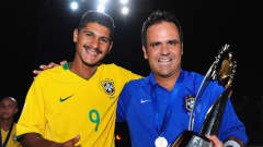 DUBAI, UNITED ARAB EMIRATES - NOVEMBER 22: Andre and coach Alexandre Soares of Brazil celebrate victory in the FIFA Beach Soccer World Cup Final between Brazil and Switzerland at Umm Suqeim beach on November 22, 2009 in Dubai, United Arab Emirates. (Photo by Mike Hewitt - FIFA/FIFA via Getty Images)