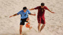DUBAI, UNITED ARAB EMIRATES - NOVEMBER 22: Fabian of Uruguay is challenged by Beirao Sousa of Portugal during the FIFA Beach Soccer World Cup 3rd Place Playoff match between Portugal and Uruguay on November 22, 2009 in Dubai, United Arab Emirates. (Photo by Michael Regan - FIFA/FIFA via Getty Images)