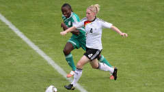 BIELEFELD, GERMANY - AUGUST 01:  Marith Priessen (R) of Germany and Ebere Orji (L) of Nigeria battle for the ball during the FIFA U20 Women's World Cup Final match between Germany and Nigeria at the FIFA U-20 Women's World Cup stadium on August 1, 2010 in Bielefeld, Germany.  (Photo by Friedemann Vogel - FIFA/FIFA via Getty Images)