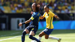 RIO DE JANEIRO, BRAZIL - AUGUST 16:  Lotta Schelin of Sweden and Poliana of Brazil in action during the Women's Football Semi Final between Brazil and Sweden on Day 11 of the Rio 2016 Olympic Games at Maracana Stadium on August 16, 2016 in Rio de Janeiro, Brazil.  (Photo by Buda Mendes/Getty Images)