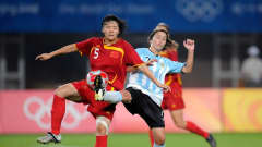 Xinzhi WENG (CHN) and Ludmila MANICLER (ARG) fighting for the ball during the China : Argentina at the Qinghuangdao Olympic Stadium on August 12, 2008.