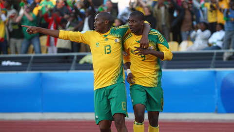 RUSTENBURG, SOUTH AFRICA - JUNE 28: Katlego Mphela (R) of South Africa celebrates after scoring the first goal with Kagisho Evidence Dikgacoi during the FIFA Confederations Cup 3rd Place Playoff match between Spain and South Africa at the Royal Bafokeng Stadium on June 28, 2009 in Rustenburg, South Africa. (Photo by Christof Koepsel/Bongarts/Getty Images)
