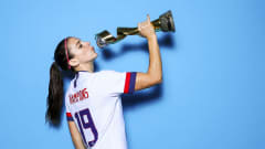 Alex Morgan poses with the trophy