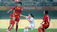 Bi Yan(CHN) popped up for a header in the match between China and Canada (Group E) at the Tianjin Olympic Sports Center Stadium on 9 August 2008.