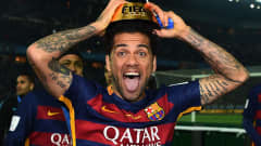 YOKOHAMA, JAPAN - DECEMBER 20:  Dani Alves of Barcelona celebrates with the trophy following his team's 3-0 victory during the FIFA Club World Cup Final between River Plate and FC Barcelona at the International Stadium Yokohama on December 20, 2015 in Yokohama, Japan.  (Photo by Shaun Botterill - FIFA/FIFA via Getty Images)
