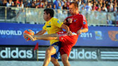 RAVENNA, ITALY - SEPTEMBER 11: Betinho of Brazil is challenged by Anton Shkarin of Russia during the FIFA Beach Soccer World Cup Final between Russia and Brazil at Stadium del Mare on September 11, 2011 in Ravenna, Italy.  (Photo by Lars Baron - FIFA/FIFA via Getty Images)