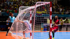 Cristian Borruto (L) of Argentina scores the opening goal during the FIFA Futsal World Cup Semi-Final match between Argentina and Portugal at the Coliseo El Pueblo stadium on September 28, 2016 in Cali, Colombia.  (Photo by Alex Caparros - FIFA/FIFA via Getty Images)