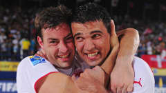 DUBAI, UNITED ARAB EMIRATES - NOVEMBER 20: Dejan Stankovic (R) and Mo Jaeggy of Switzerland celebrate victory in the FIFA Beach Soccer World Cup Quarter Final match between Russia and Switzerland at Umm Sequim beach on November 20, 2009 in Dubai, United Arab Emirates. (Photo by Mike Hewitt - FIFA/FIFA via Getty Images)