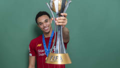 DOHA, QATAR - DECEMBER 21: Trent Alexander-Arnold of Liverpool poses with the Club World Cup trophy after the FIFA Club World Cup Qatar 2019 Final match between Liverpool and CR Flamengo at Khalifa International Stadium on December 21, 2019 in Doha, Qatar. (Photo by David Ramos - FIFA/FIFA via Getty Images)