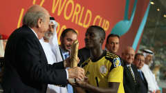 ABU DHABI, UNITED ARAB EMIRATES - NOVEMBER 08:  Dele Alampasu of Nigeria recieves the Golden Glove awards from  FIFA President Joseph S. Blatter during the FIFA U-17 World Cup UAE 2013 Final between Nigeria and Mexico at the Mohamed Bin Zayed Stadium on November 8, 2013 in Abu Dhabi, United Arab Emirates.  (Photo by Richard Heathcote - FIFA/FIFA via Getty Images)