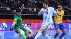 KAUNAS, LITHUANIA - SEPTEMBER 29: Alan Brandi of Argentina shoots under pressure from Guitta, Marlon and Dieguinho of Brazil during the FIFA Futsal World Cup 2021 Semi-Final match between Brazil and Argentina at Kaunas Arena on September 29, 2021 in Kaunas, Lithuania. (Photo by Alex Caparros - FIFA/FIFA via Getty Images)
