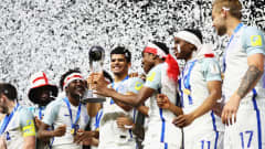 SUWON, SOUTH KOREA - JUNE 11:  Dominic Solanke of England lifts the trophy in victory with team mates after the FIFA U-20 World Cup Korea Republic 2017 Final between Venezuela and England at Suwon World Cup Stadium on June 11, 2017 in Suwon, South Korea. England defeated Venezuela 1-0.  (Photo by Maddie Meyer - FIFA/FIFA via Getty Images)