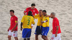 DUBAI, UNITED ARAB EMIRATES - NOVEMBER 22: Andre of Brazil celebrates with team mates Bueno and Buru after scoring during the FIFA Beach Soccer World Cup Final between Brazil and Switzerland at Umm Suqeim beach on November 22, 2009 in Dubai, United Arab Emirates. (Photo by Mike Hewitt - FIFA/FIFA via Getty Images)