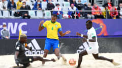 MOSCOW, RUSSIA - AUGUST 26: Catarino of Brazil is challenged by Al Seyni Ndiaye of Senegal during the FIFA Beach Soccer World Cup 2021 Quarter-final match between Senegal and Brazil at Luzhniki Beach Soccer Stadium on August 26, 2021 in Moscow, Russia. (Photo by Octavio Passos - FIFA/FIFA via Getty Images)