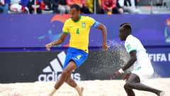 MOSCOW, RUSSIA - AUGUST 26: Catarino of Brazil battles for possession with Mamour Diagne of Senegal during the FIFA Beach Soccer World Cup 2021 Quarter-final match between Senegal and Brazil at Luzhniki Beach Soccer Stadium on August 26, 2021 in Moscow, Russia. (Photo by Octavio Passos - FIFA/FIFA via Getty Images)