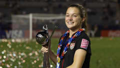 TOKYO, JAPAN - SEPTEMBER 08:  Kealia Ohai of the USA celebrates with the trophy after the USA won the FIFA U-20 Women's World Cup Final match between USA and Germany at the National Stadium on September 8, 2012 in Tokyo, Japan.