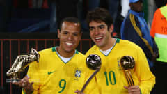 JOHANNESBURG, SOUTH AFRICA - JUNE 28: Luis Fabiano (L) of Brazil poses with the adidas Silver Ball awarded to the second most outstanding player of the tournament and the adidas Golden Shoe awarded for the tournaments top scorer, as team mate Kaka poses with the adidas Golden Ball awarded to the most outstanding player of the tournament at the end of the FIFA Confederations Cup Final between USA and Brazil at the Ellis Park Stadium on June 28, 2009 in Johannesburg, South Africa. (Photo by Alex Livesey/Getty Images)